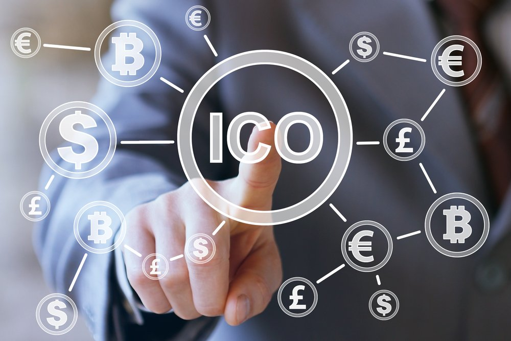 Businessman presses currencies button ICO Initial Coin Offering