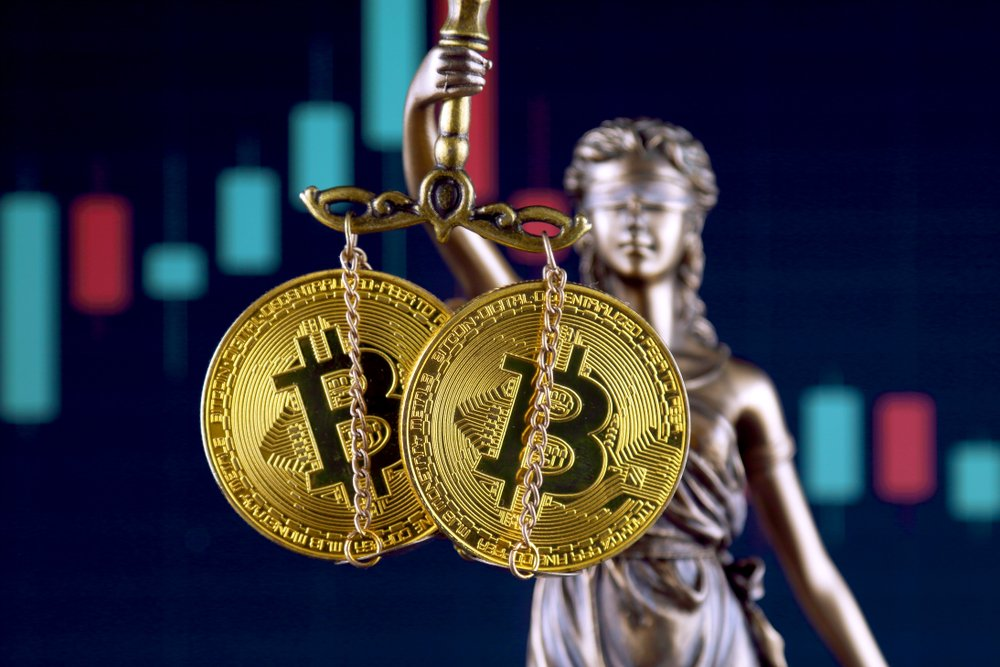 Symbol of law and justice and physical version of Bitcoin