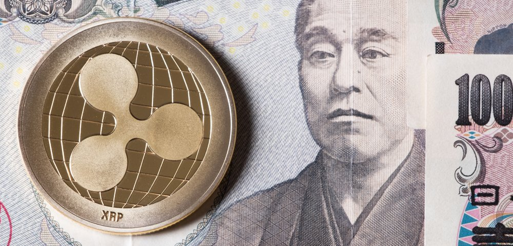 Ripple coin crypto currency on Japanese yen bank notes