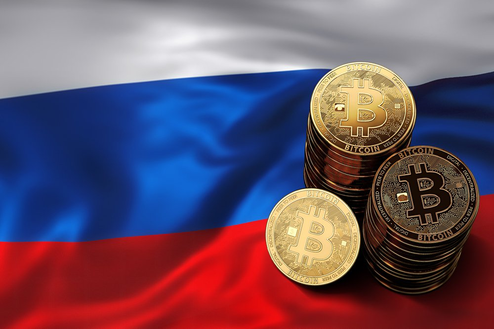 Stack of Bitcoin coins on Russian flag