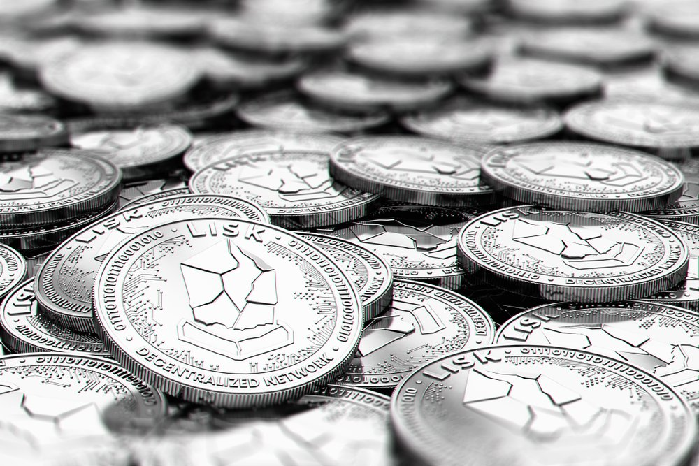 Stack of silver LISK coins in blurry closeup