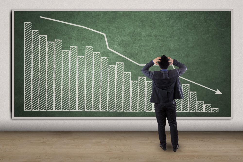 disappointed businessman looking at chart