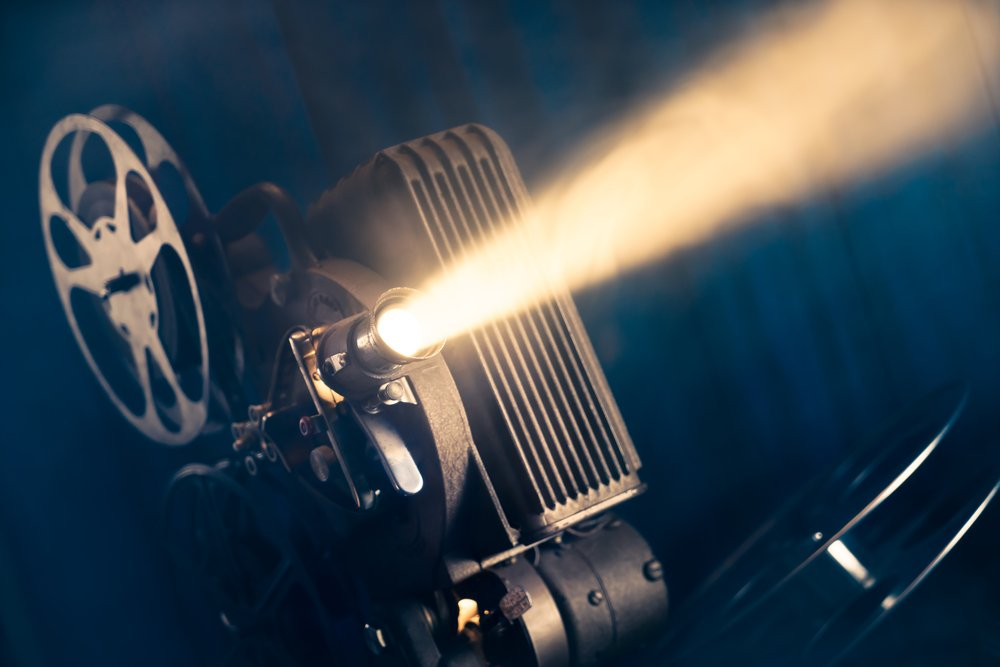 film projector on a wooden background with dramatic lighting