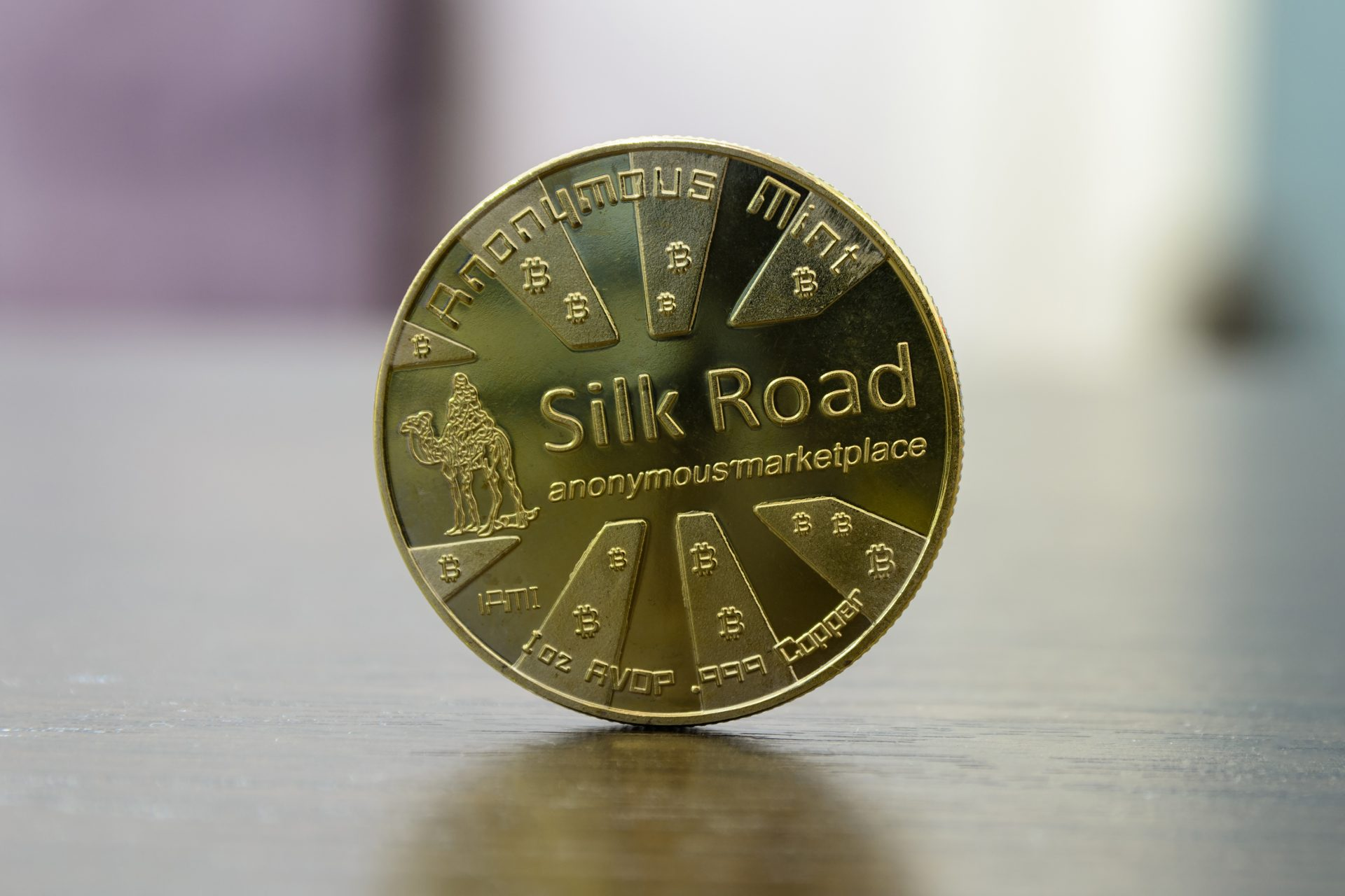 golden bitcoin silk road stand on table
