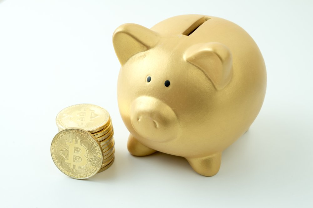 piggy bank with Stack of Cryptocurrency coins
