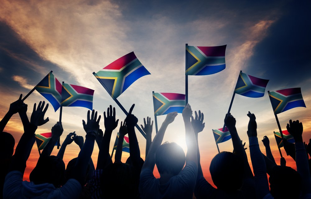 people waving south african flags