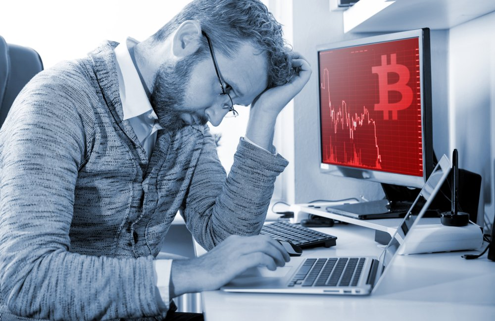 Depressed investor analyzing crisis bitcoin