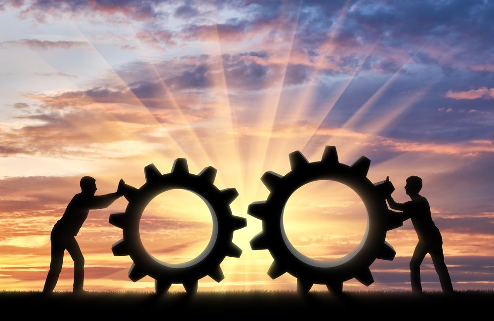 two cogs being pushed together