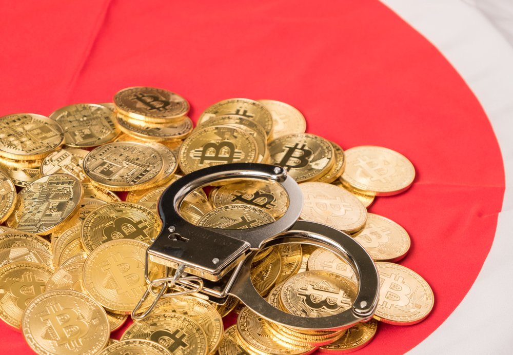 japan flag crypto handcuffs